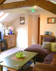 Beamed sitting room with cosy fire & TV/DVD for those cosy nights in!