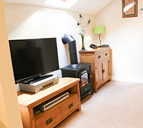 "Flat screen 32"" LED TV, Freeview, DVD and iPod Player. Videos and books supplied"
